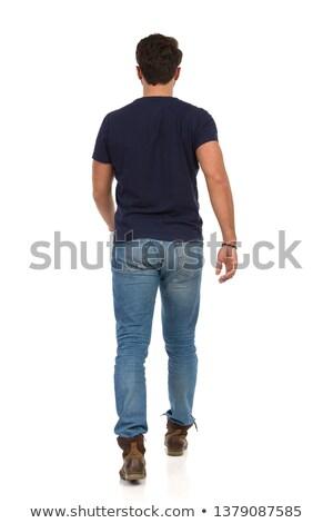 hombre · mirando · pared · joven - foto stock © stockyimages