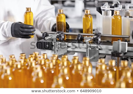 White plastic soap bottles in rows assembly line Stock photo © lunamarina