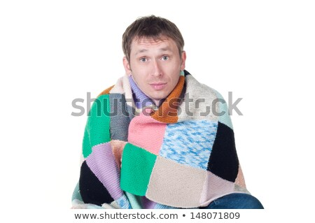 man wrapped in a warm blanket shivering from the cold stock photo © tarikvision
