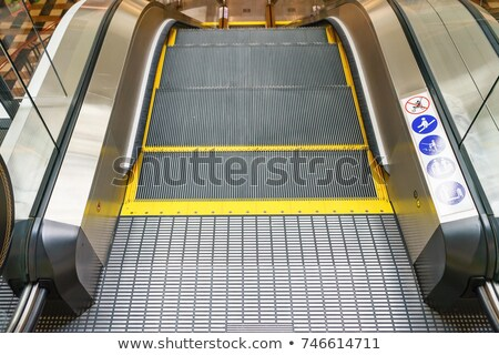 moving escalator in airport stock photo © kawing921