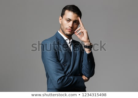 business man holds fingers at temples stock photo © feedough