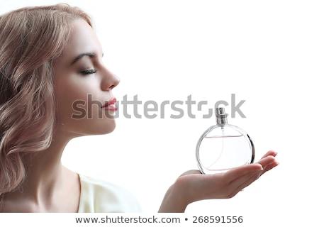 beautiful girl holding perfume bottle isolated on white stock photo © lordalea