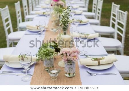 Esküvő asztal díszítések étel italok virágok Stock fotó © amok