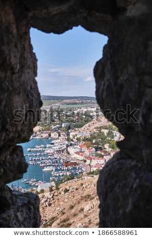 Motorboat in a sea viewed through in a pier Stock photo © bmonteny