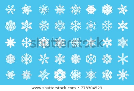 Abstract snowflake shapes isolated on blue background. Stock photo © lenapix