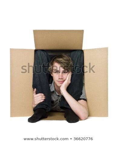 Acrobat inside of a cardboard box. stock photo © gemenacom