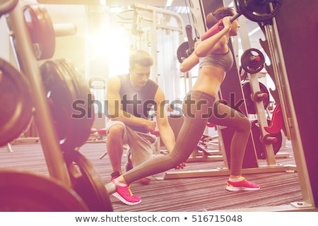 Trainer for fitness and weightlifting in the gym Stock photo © studiostoks