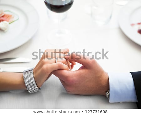 Man holding his girlfriend's hand at the restaurant Stock photo © deandrobot