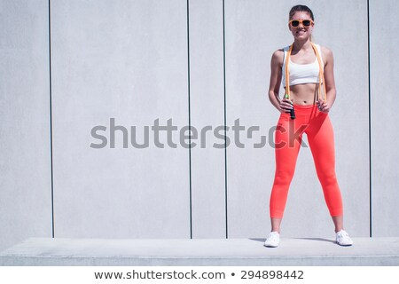 Fit Woman Holding Jumping Rope Over her Shoulders Stock photo © stryjek