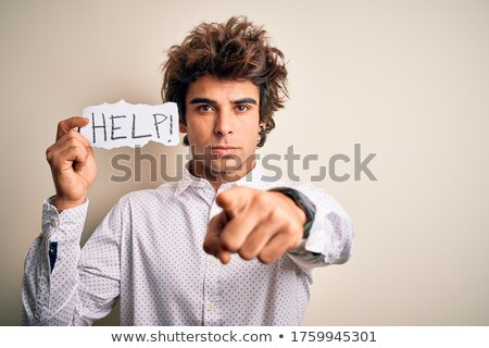 Young serious businessman pointing at camera Stock photo © wavebreak_media