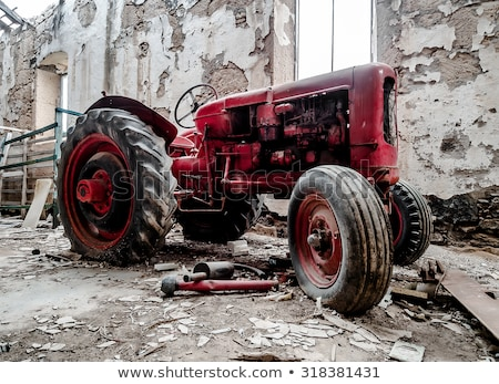 Old, broken tractor indoors Stock photo © amok