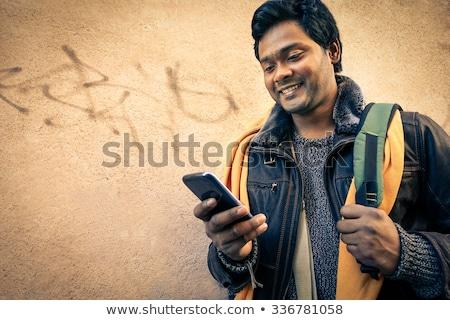 Férfi sms üzenetküldés mobiltelefon mosolyog boldogság kapcsolat Stock fotó © imagedb