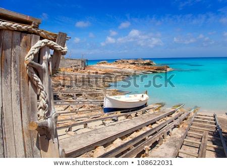 Boot houten strand zee achtergrond zwarte Stockfoto © lunamarina