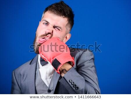 Punched businessman Stock photo © alphaspirit