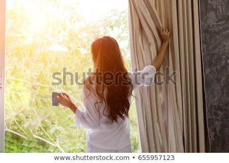 girl at field looking at the home stock photo © paha_l