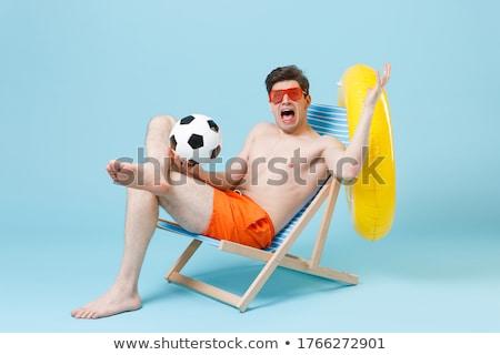 displeased boy at the beach  Stock photo © meinzahn