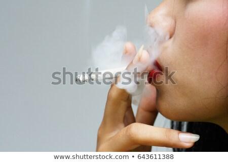 atraente · mulher · jovem · fumador · cigarro · branco - foto stock © zurijeta