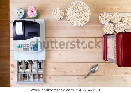 Bowls of fresh popcorn alongside a till Stock photo © ozgur