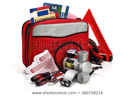 Stock photo: Emergency kit for car - first aid kit, car jack, jumper cables, warning triangle, light bulb kit,