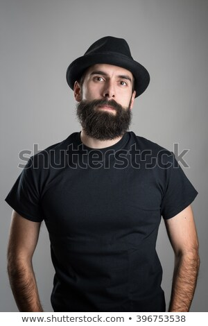 Vertical image of Serious Hipster in shirt Stock photo © deandrobot