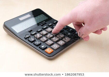 Hand Finger Press Budget Key. Stock photo © tashatuvango