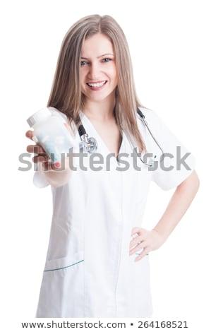 female doctor holding unlabeled bottle of various pills and medi stock photo © stevanovicigor