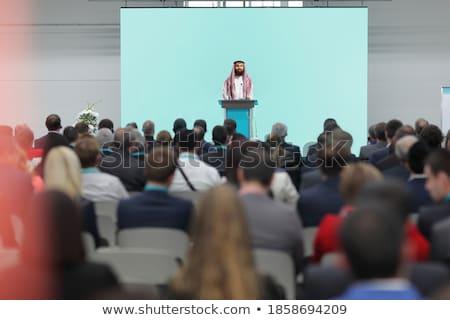 Bearded arabic businessman speech on tribune Stock photo © studioworkstock