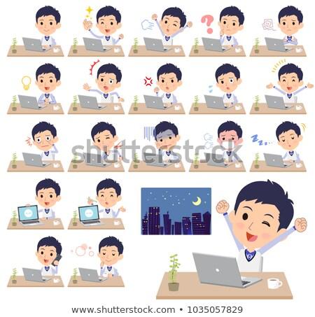 Store personeel Blauw uniform werk computer Stockfoto © toyotoyo