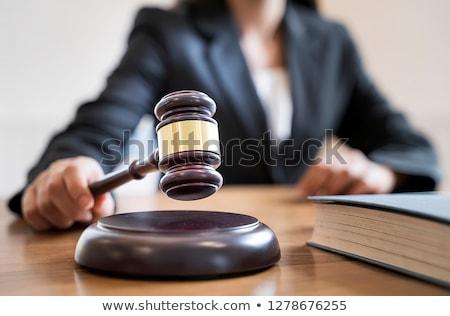 hand holding law gavel stock photo © neirfy