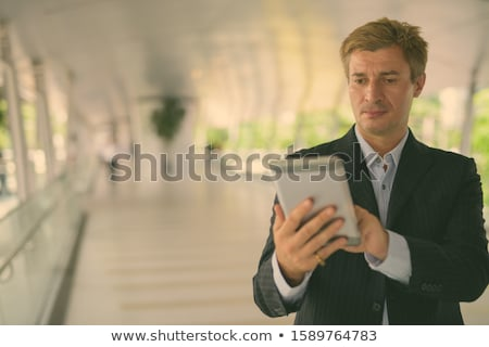 Businessman relaxing at the footbridge in Bangkok, Thailand Stock photo © amazingmikael