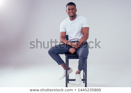 Portrait of a happy young african man stock photo © deandrobot