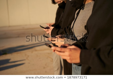 group of four happy smartly dressed friends stock photo © deandrobot