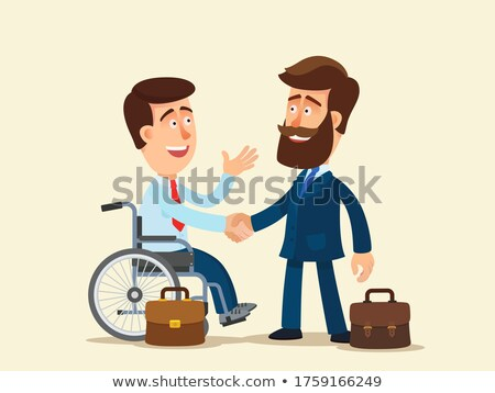 disabled businessman shaking hand with his colleague stock photo © andreypopov
