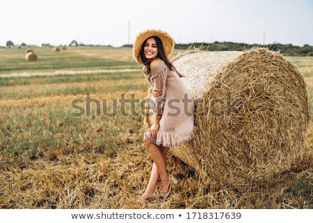 Cropped image of woman in dress, straw hat and sunglasses Stock photo © deandrobot