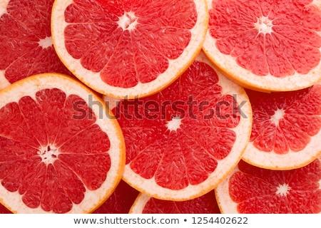 Közelkép friss lédús grapefruit étel gyümölcsök Stock fotó © dolgachov