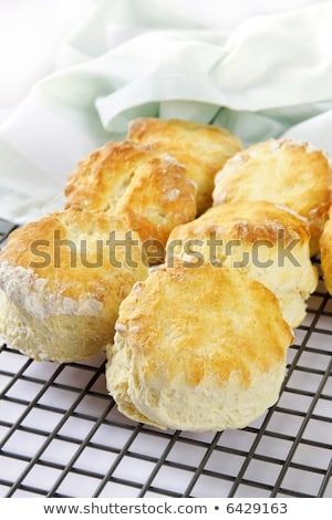 Home made scones with strawberry jam and a cup of tea Stock photo © Melnyk