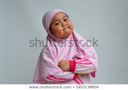 Young muslim woman in hijab crossing her arms on chest Stock photo © pressmaster