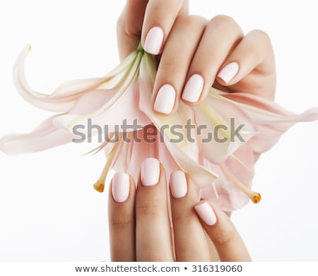 Beauty delicate hands with manicure close up. Beautiful female fingers with manicure and fashionable Stock photo © serdechny