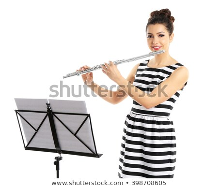 Young flautist with music sheet Stock photo © ra2studio