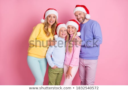 Mom and son family photo on new year's eve on the background of glowing garlands and Christmas decor Stock photo © ElenaBatkova