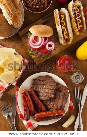 A BBQ with Hamburger, Bread and hot dog Stock photo © Lopolo