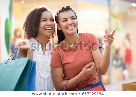 teenage girl pointing finger up in shopping mall Stock photo © dolgachov