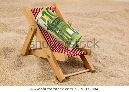 Euros billetes cubierta silla miniatura playa Foto stock © AndreyPopov