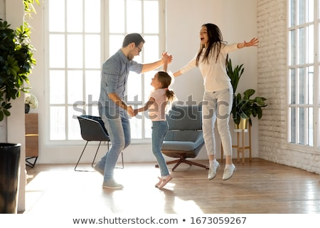 Three people have good time together: mother, father and small d Stock photo © vkstudio