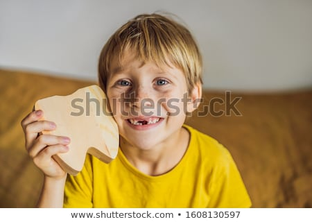 A boy, 6 years old, holds a box for milk teeth. Change of teeth Stock photo © galitskaya