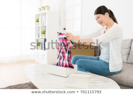 Buying new clothes Asian woman happy looking at purchase of fashion white top from clothing store pa Stock photo © Maridav