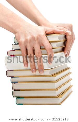 Feminine hands keeps pile of the books Stock photo © RuslanOmega