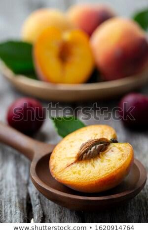 Green grapes bunch and one orange peach. Stock photo © boroda