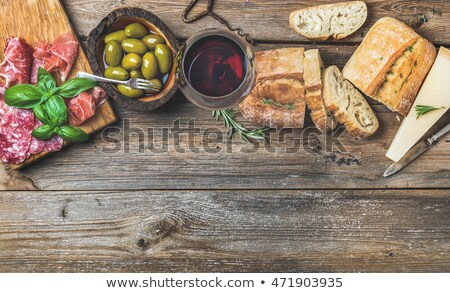 Parmesan cheese, salame and red wine - horizontal close up Stock photo © bugstomper