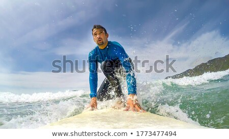 surfers on green sea in Italy Stock photo © prill